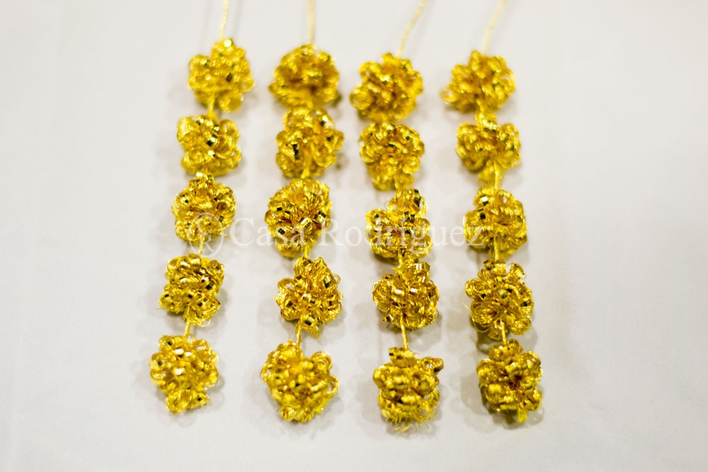 Flecos caireles oro